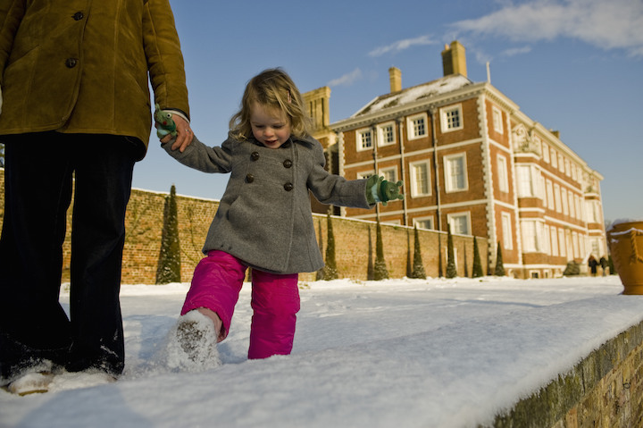 Visitors enjoying the snow in the garden at Ham House, Richmond-upon-Thames.