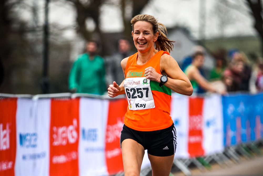Woman running in Surrey Half Marathon
