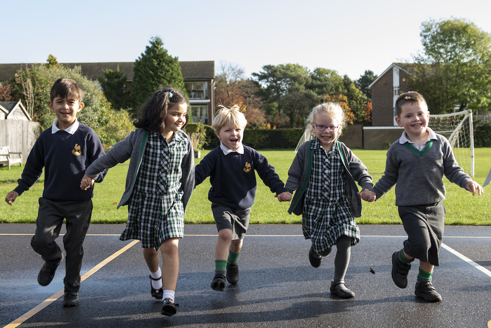children running at Chinthurst School