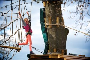 girl on rope climbing frame at skywalk adventure