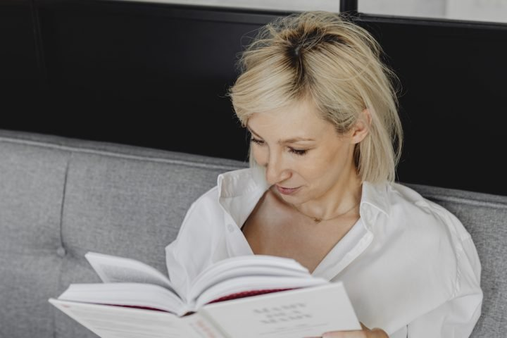 Attractive women reading a book