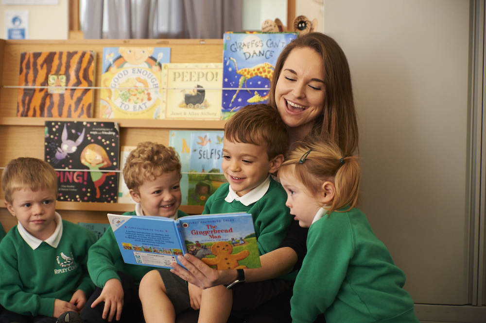 Kids reading at Ripley Court School, Ripley Surrey