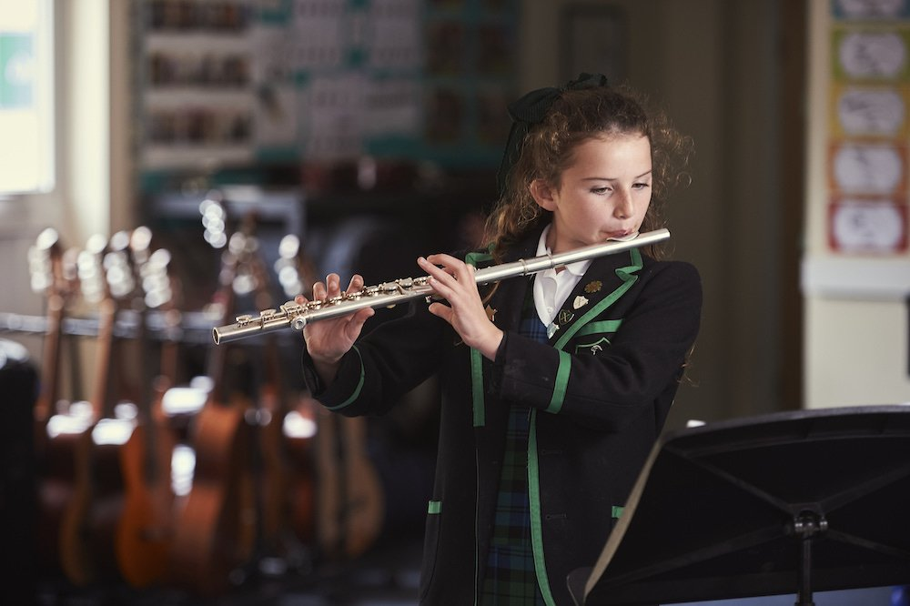Girl playing the flute, Ripley Court School, Ripley, Surrey